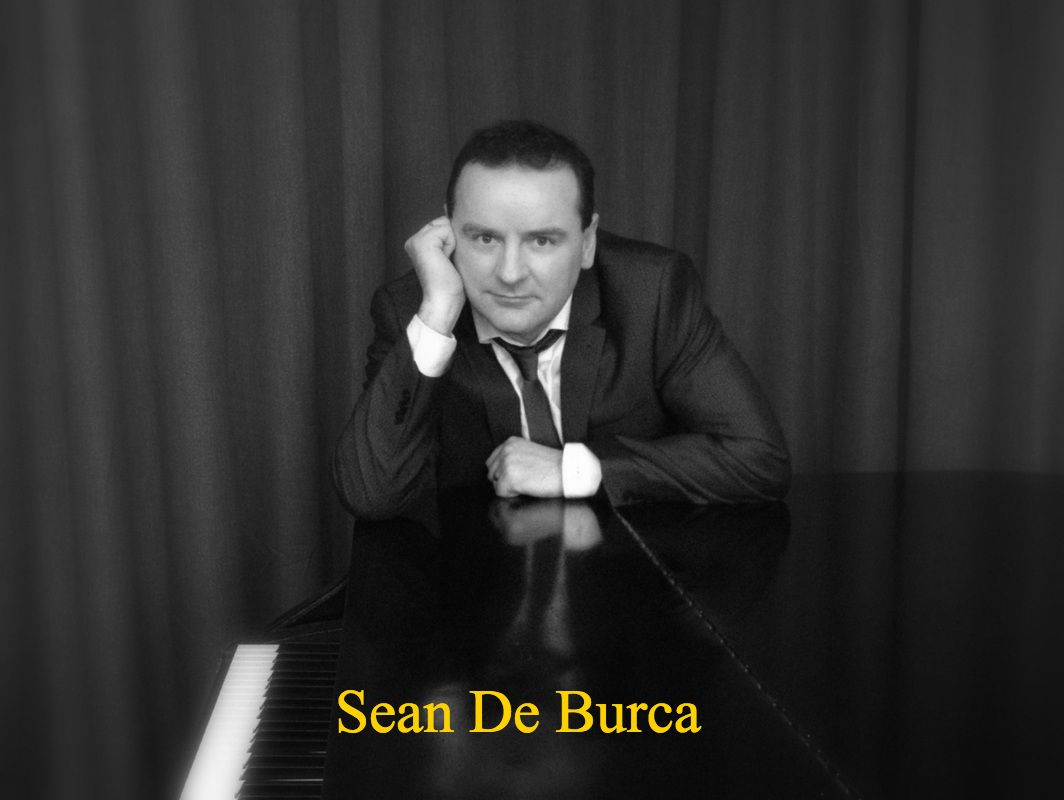 Photo of sean De Burca at a Piano